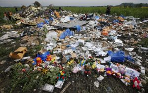 Flowers and mementos placed at the crash site of Malaysia Airlines Flight MH17 are pictured near the settlement of Rozspyne in the Donetsk region July 19, 2014. Ukraine accused Russia and pro-Moscow rebels on Saturday of destroying evidence to cover up their guilt in the shooting down of the Malaysian airliner that has accelerated a showdown between the Kremlin and Western powers. REUTERS/Maxim Zmeyev (UKRAINE - Tags: TRANSPORT POLITICS DISASTER CIVIL UNREST TPX IMAGES OF THE DAY) - RTR3ZCPP